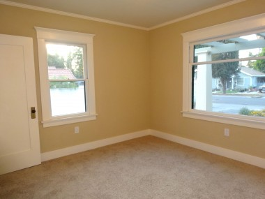 Front bedroom with new carpet, paint and light fixture.