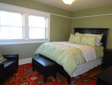 One of three upstairs bedrooms with walk-in closet, lots of light, and hardwood flooring!