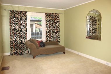 Middle bedroom with walk-in closet and carpeting.