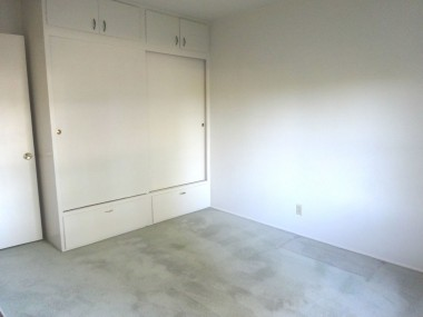 All four of the secondary bedrooms have spacious closets like this. Upper cabinets and lower drawers.