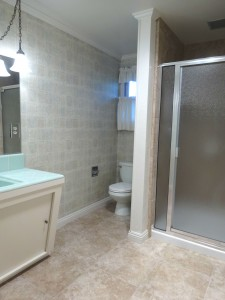 Hallway bathroom was partially remodeled. There was a step-in therapy tub that has been replaced with a brand new tile-enclosed shower and tile floor.