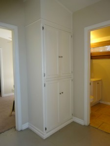 Hallway between all the bedrooms with ample storage.
