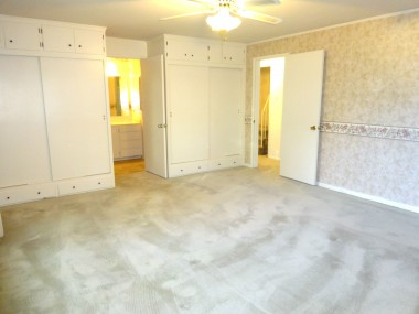 Main floor master bedroom suite with window seat, his/hers closets and private 3/4 bathroom.