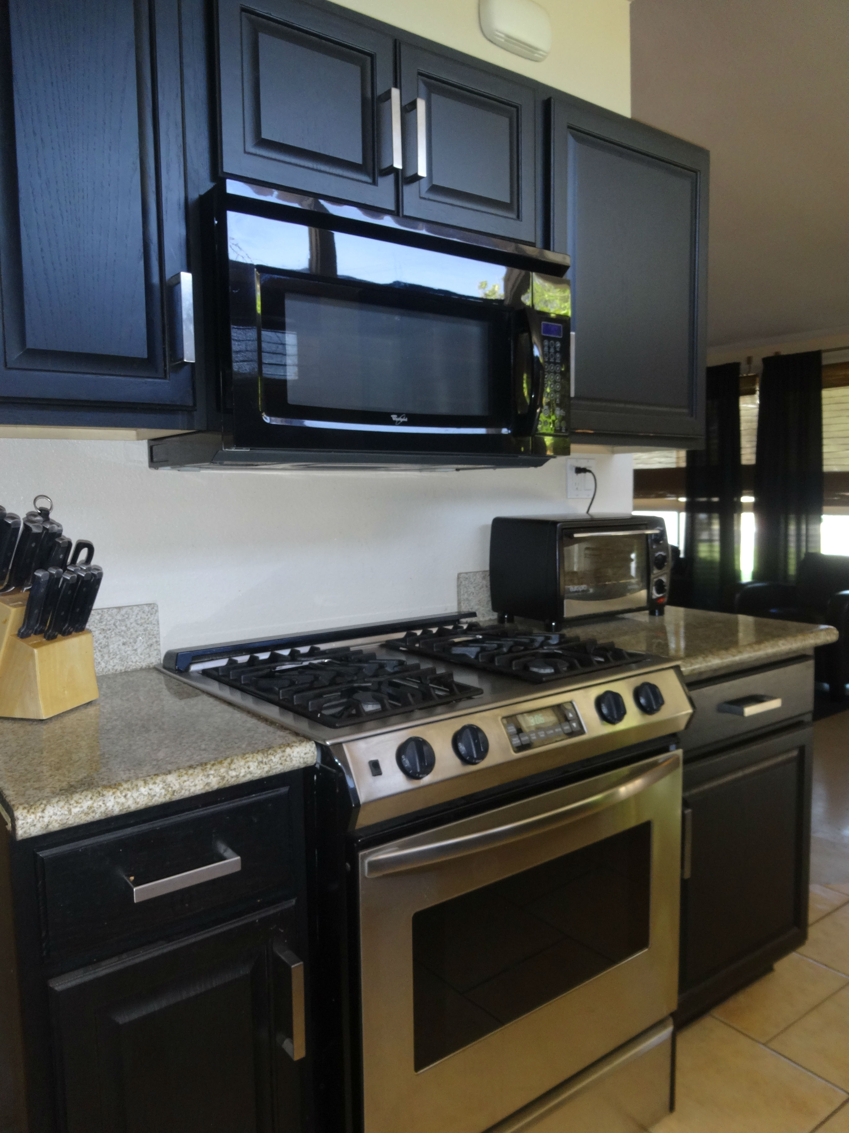Gas stainless steel stove and built-in microwave in lovely remodeled kitchen!