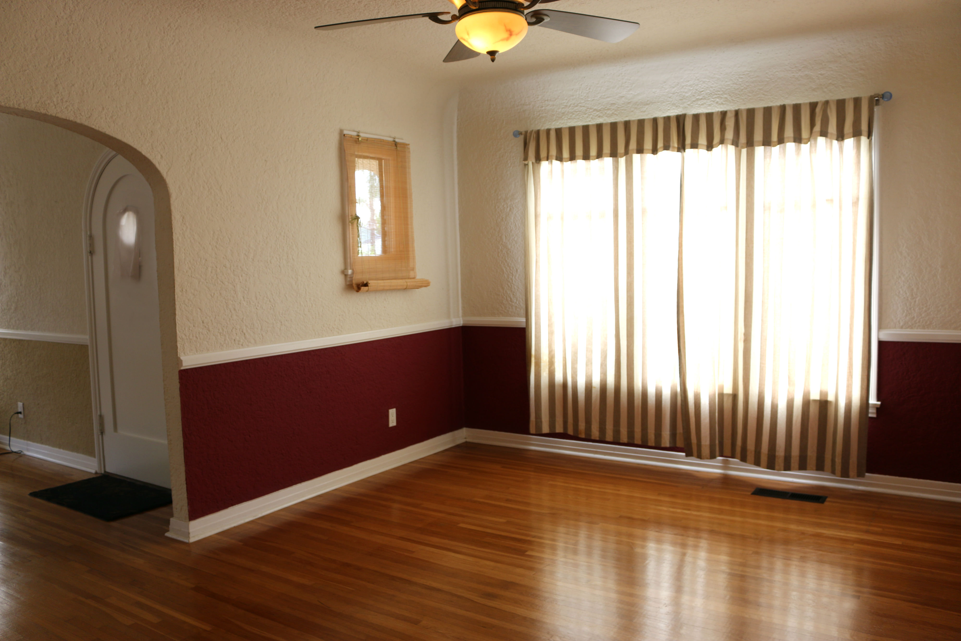 Coved Ceiling In Formal Dining Room With Fan And Gorgeous Hardwood Floors
