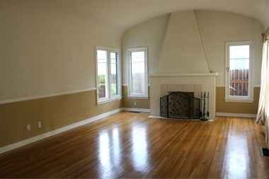 Impressive barrel ceiling with gorgeous  hardwood floors and decorative  fireplace.