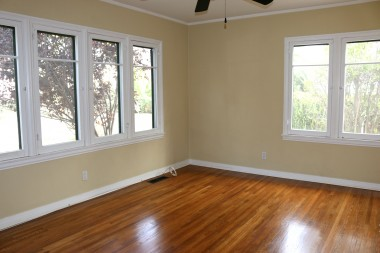 All three bedrooms have exposed  hardwood floors. This is one of the two  back bedrooms that overlooks the  backyard. Lots of natural light due to all  the windows.