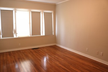 All three bedrooms have exposed  hardwood flooring.