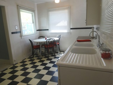 Eat-in kitchen with ceiling fan, and space  for table and refrigerator.