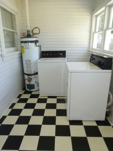 Separate laundry room with newer water  heater and washer/dryer, which are  included.
