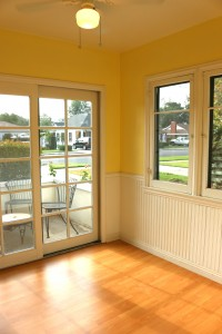 Breakfast nook with lots of natural light  and sliding door to quaint patio for  morning coffee!