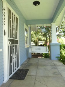 Sweet front porch including porch swing and custom-screened security door.