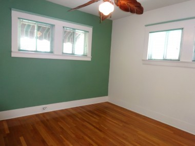 One of the two bedrooms (this one comfortably fits a California King and also has double pane windows). The other bedroom has a custom built-in closet dresser.