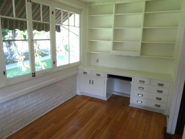 Sitting room/library with built-in book  shelves and desk. Hardwood floors too!