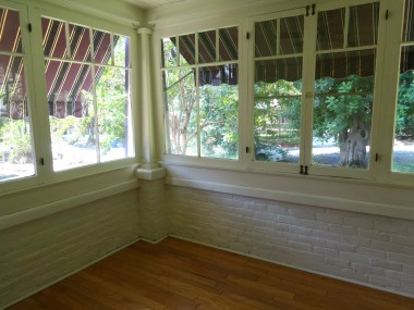 Alternate view of sitting room/library.  Enjoy the view of greenery and lovely  trees in this neighborhood!