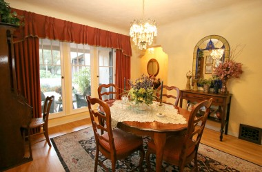Formal dining room with coved ceiling and hardwood floors.