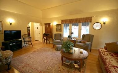 Alternate view of living room, looking towards the front door.