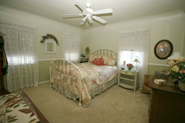 Another of the three bedrooms, this one with carpeting.