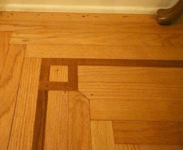 Magnified view of inlaid hardwood floors.