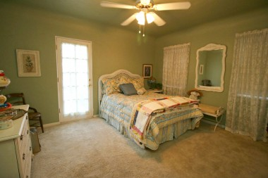 Master bedroom with attached half bath and separate entrance.
