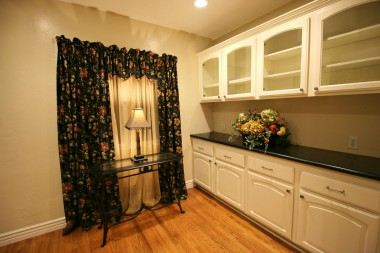 Charming breakfast nook with recessed lighting, and built-in drawers and display cabinetry.