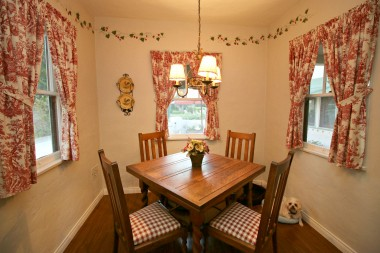 Breakfast nook with corner hutch (see next photo).