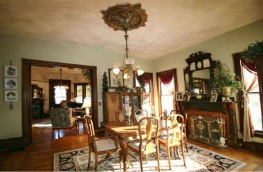 Formal dining room with gas fireplace #3, hardwood floors, chandelier and medallion, and three sets of pocket doors. High end period-accurate curtains were custom made for this home, as well as the cloud effect painted on most of the ceilings.