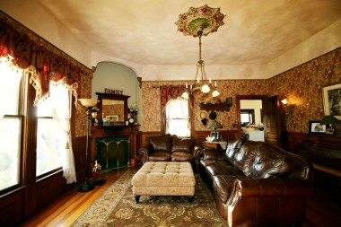 Spacious family room with gas fireplace #4 and with hardwood floors, and another original chandelier with medallion.