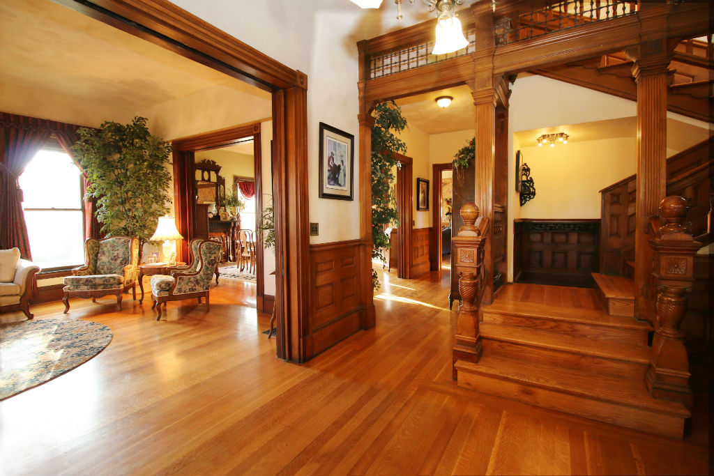 View as you enter the home. Stairway, long hallway leading to the kitchen, and to your left is the formal living room with two sets of pocket doors.