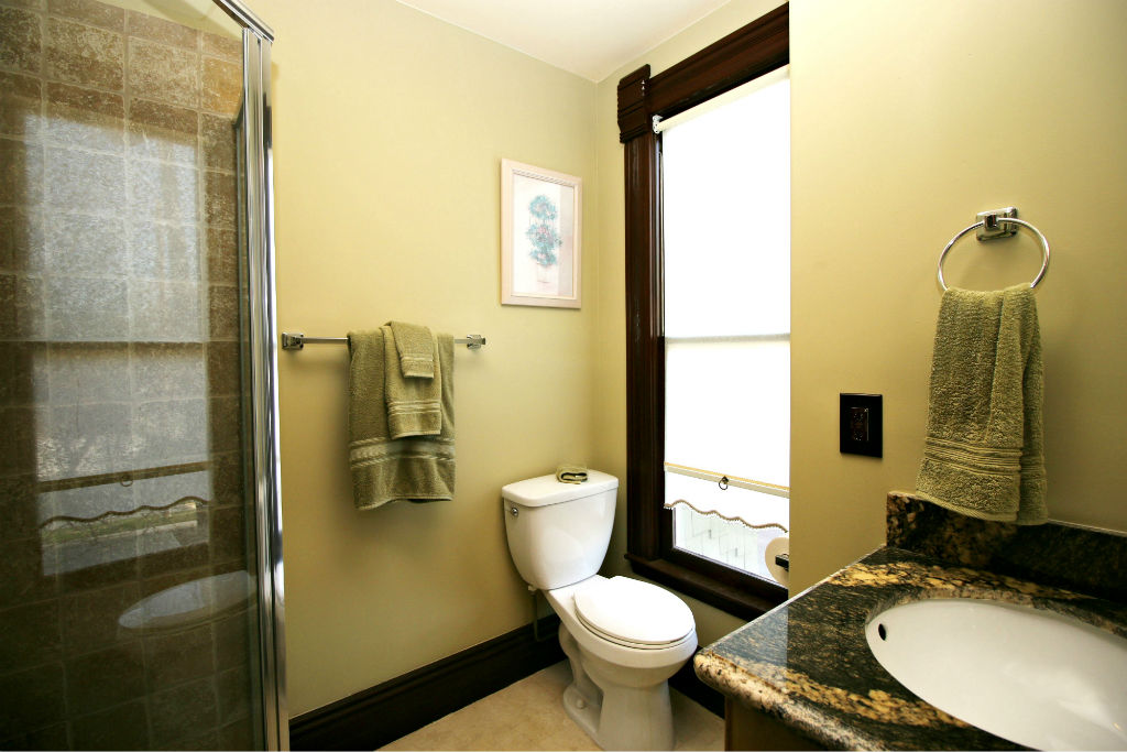 Private remodeled bathroom for second bedroom. Granite counter top and separate shower stall.