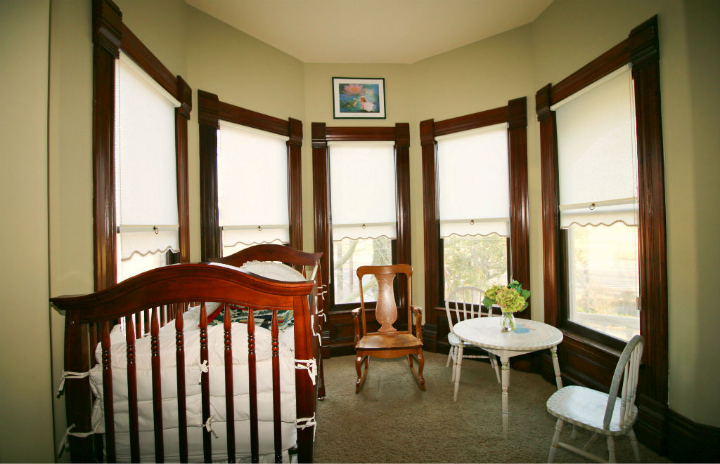 Close up view of second bedroom's turret with extra space for more furniture. Custom-made beaded period-accurate window shades.