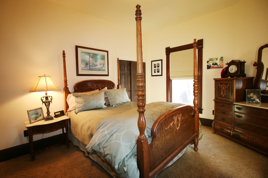 Third and fourth bedrooms share a jack and jill bathroom. This is the third bedroom, whereas the fourth bedroom has exposed hardwood floors and is currently being utilized as a home gym.