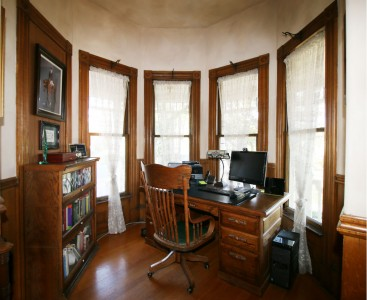 Office enclave to the right as you enter the home, with original windows and hardwood floors.