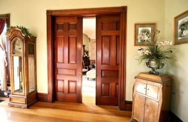 There are FOUR sets of working double pocket doors, this set which separates the living room from the formal dining room. They open so easily you could use your pinkie finger.