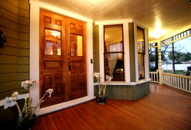 Front porch, double door entry, and another set of double doors just inside, like a mudroom you'd see in east coast homes. The original owner (Samuel A. Ames) was from Massachusetts and was once a Pony Express mail carrier!