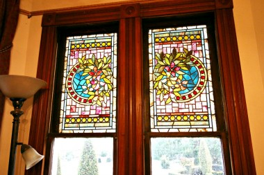 ORIGINAL stained glass windows above grand piano in living room.