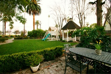 Spacious side yard with swing set (will not stay) and lighted gazebo (stays). Yard is large enough to accommodate wedding parties or family reunions.