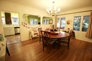 Spacious formal dining room with original hardwood floors and coved ceiling. Wall was opened in two places between kitchen and dining to open the space and allow more light and communication between the rooms.