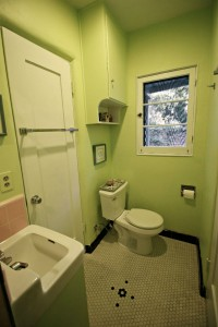 Small but mighty 3/4 bathroom with original floor tile and sink. Cute, cute, cute!