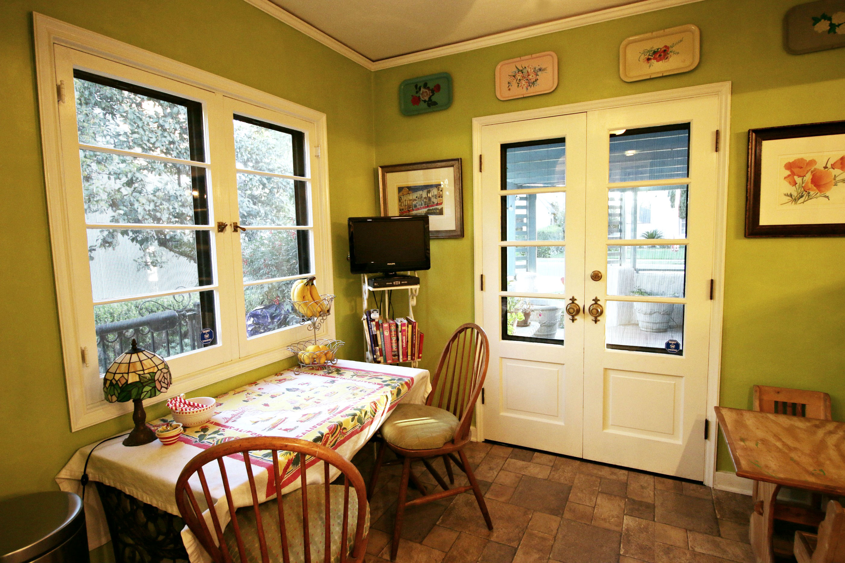 Nook area with original French doors leading to front patio for year-round Southern California al fresco dining.