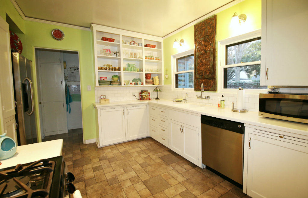 Alternate view of kitchen with open-style cabinetry.