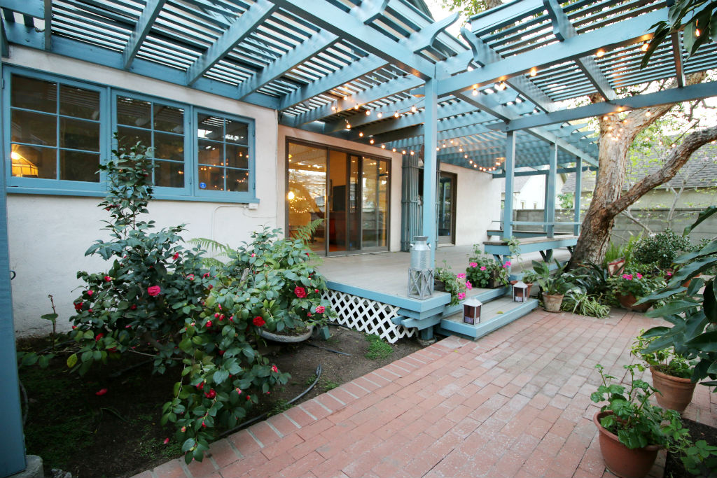Back patio with mature shade trees and the feeling of being one with nature.