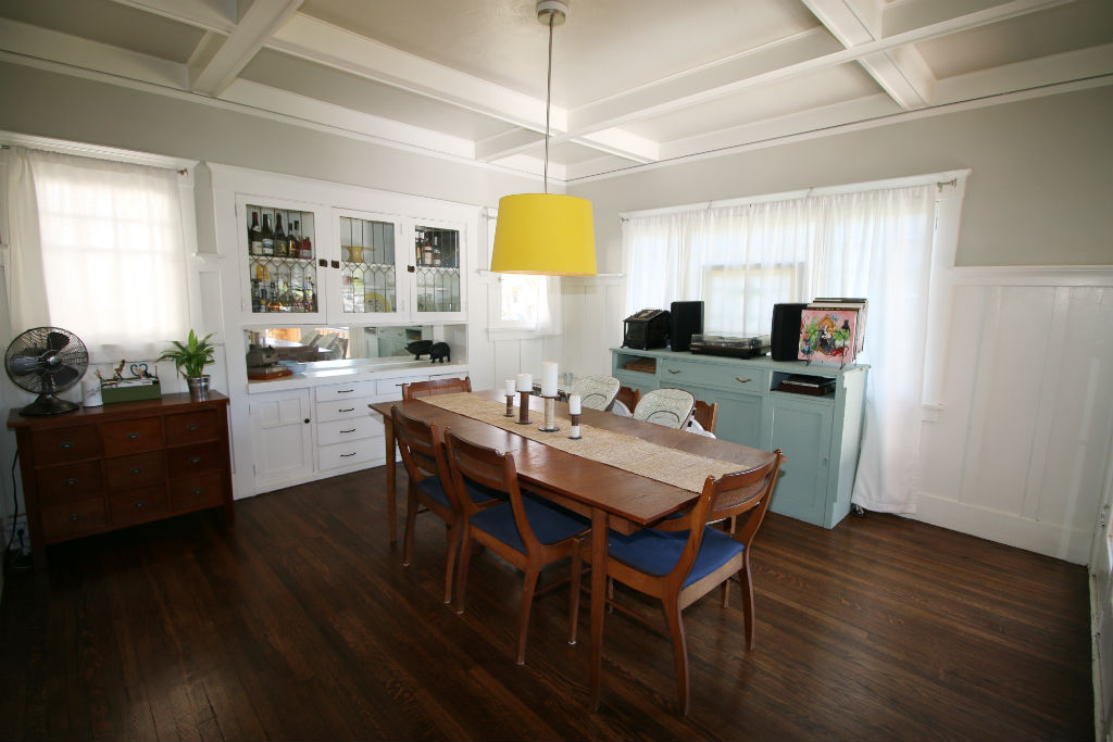 Formal dining room with hardwood floors, coffered ceiing and built-in hutch.