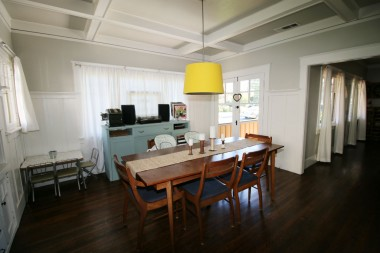 Alternate view of dining room, with view of French doors leading to the charming front porch.