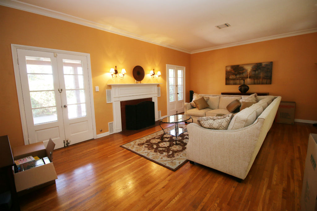 Spacious Living Room With Two Sets Of French Doors That Lead To The Charming Back Patio