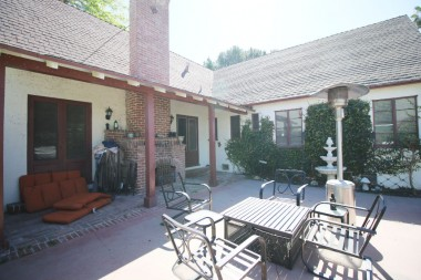 Back patio perfect for entertaining -- there's even an outdoor fireplace!!!