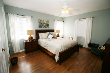 Second of three generous-sized bedrooms, all with exposed hardwood floors.