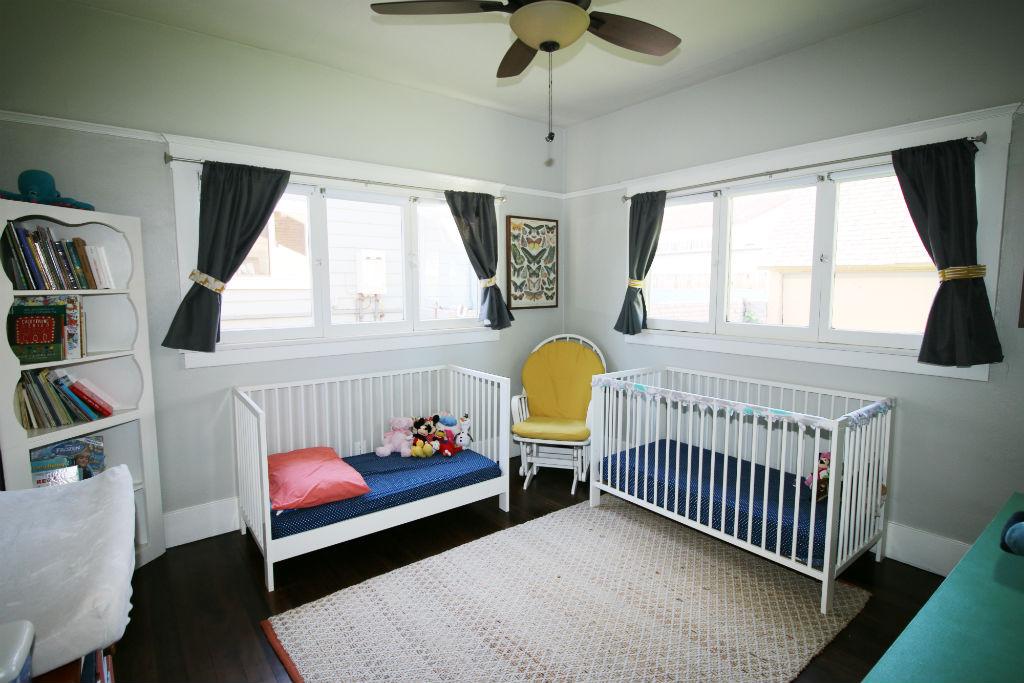 Back bedroom with exposed hardwood floors.
