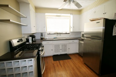 Updated kitchen with dishwasher and stainless steel appliances (frig included).