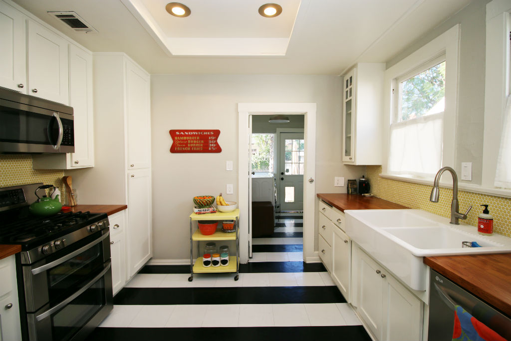 Updated kitchen with newer farm sink, newer appliances, and recessed lighting.